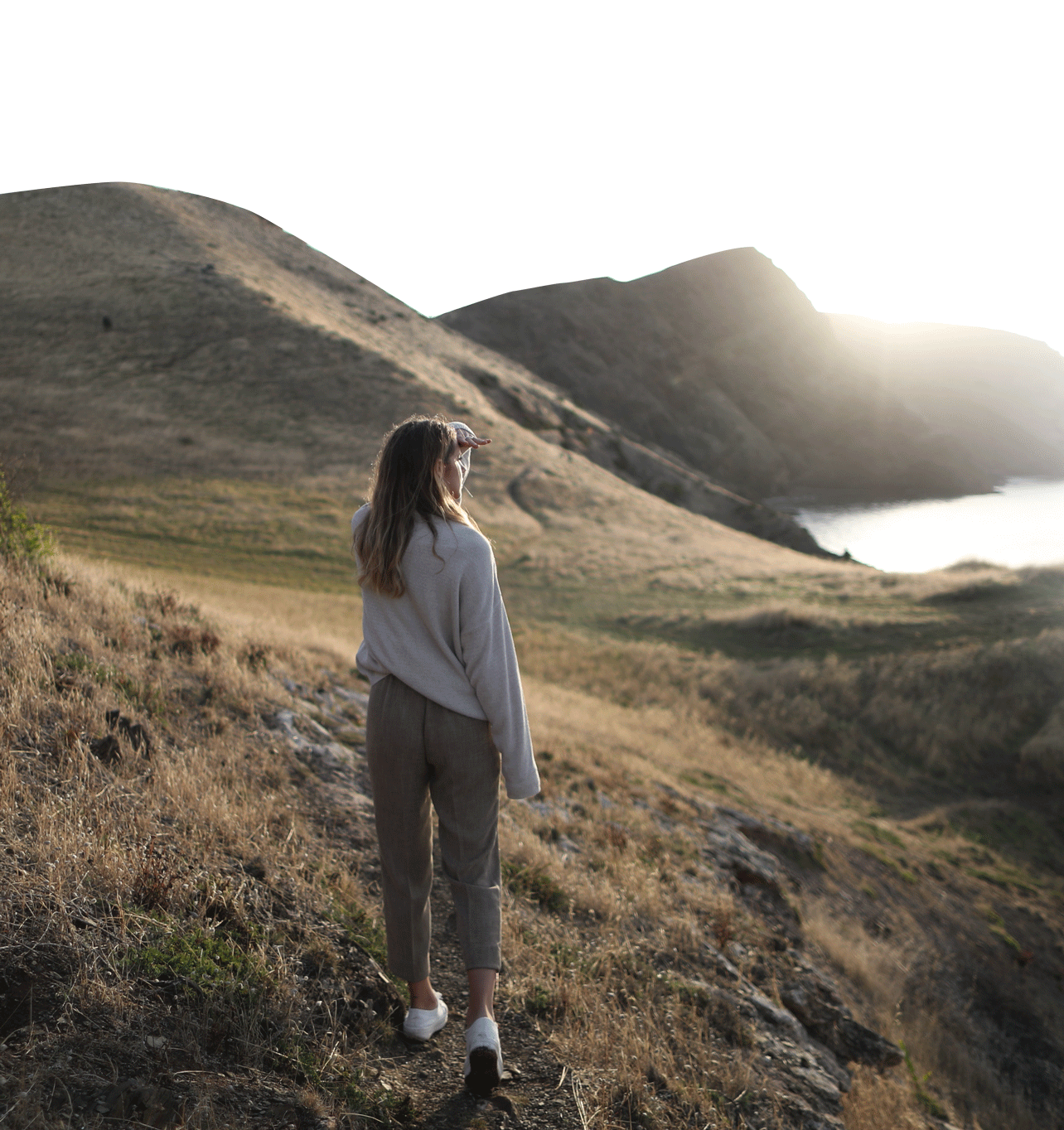 Shot of female looking out over the mountains and ocean